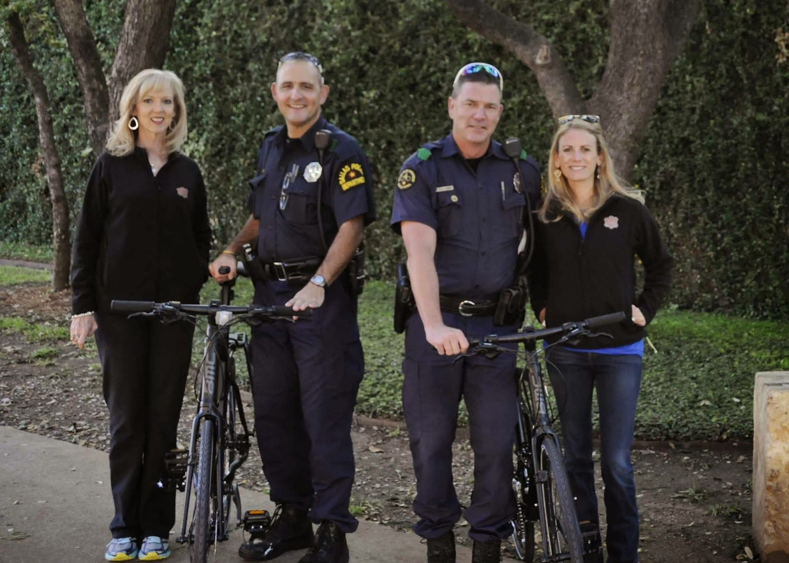 Executive Director Robin Baldock, Police Officers Phil Misgrove and Rob Readdy and Membership and Marketing Director Lauren Whitson with new donated bikes.